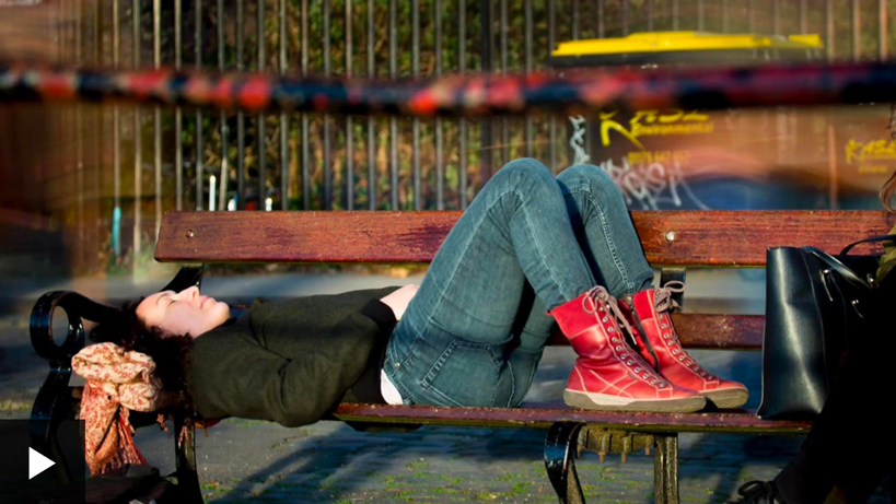 Lying down in semi-supine in public